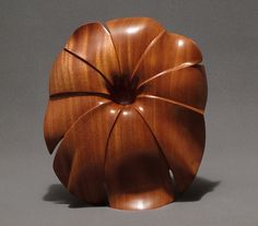 This is an exceptionally large one-of-a-kind bowl carved from a single piece of African mahogany.