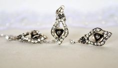 vintage style rose jewelry set art deco clear crystal rhinestone necklace earrings wedding bridal jewelry bridesmaids jewelry set by sestras on Etsy https://www.etsy.com/listing/177284405/vintage-style-rose-jewelry-set-art-deco