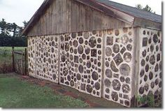 DIY sheds and buildings.  These are made by a combination of stacked logs and wood and mortar or masonry.  The outer walls can be made to look more decorative by taking tree slabs of the same or different sizes and fixing them to the outer wall using chicken wire and mortar...sort of like stucco.  -cordwood building