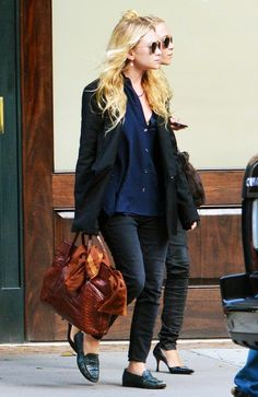 Ashley Olsen wears an oversized boyfriend blazer, a boyfriend-style button-down shirt, skinny jeans and loafers paired with a brown crocodile printed bag.