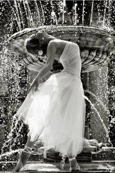 Hearing the rhythm sounds of water from fountains, she takes her cue and dances like a beautiful flower...