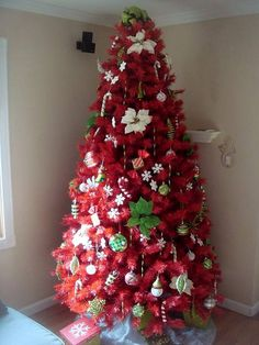 red artificial christmas trees pretty with green holly leaves added as decorations - Red Artificial Christmas Tree