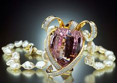 Paloma Picasso may have started as a costume jewelry designer in Paris, but she is best known for her work for Tiffany & Co. To celebrate the 100th anniversary of the famous jeweler, Picasso designed this necklace, which included a 396.30 carat kunzite gem from Afghanistan. The cushion-cut kunzite is set in a yellow gold and diamond ribbon motif pendant. And to top it all off, the necklace also contain 30 South Sea baroque pearls!