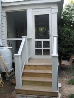 Screen porch w/ nice wood handrails on the steps.  For front steps.