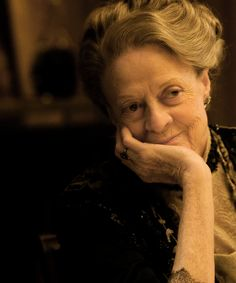 Maggie Smith as Dowager Countess Violet. Love her...another guest