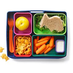 'Catch of the Day' - A fun idea for kids' bento boxes featuring a fish-shaped tuna sandwich with lettuce on whole wheat bread along side baby carrots and low-fat ranch dip. Whole-grain Goldfish crackers add to the theme and a small plum rounds out this fun kids bento box idea for young kids. #bentolunch #bentolunches #healthylunches