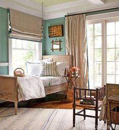 """Bedroom with teal striped wallpaper (""""Closet Stripe"""" color 362 by Farrow & Ball) and natural linen colored window treatments -- Tammy Connor Interior Design, www.tammyconnorid.com -- Hampton Showhouse -- Traditional Home"""