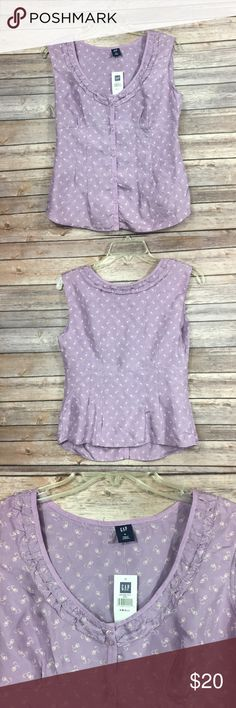 Gap women size S purple floral 100 silk top Type:top Size: S Material:100 silk Color: purple Conditions:new Country Manufacture:China   Please compare measurement to own favorite clothing to help avoid having a return. Measurements are approximate:  Shoulder:17 Width:18 Total length:24   All of my items are from a smoke free pet free-clean home GAP Tops Tank Tops