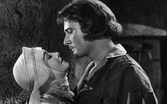 errol flynn and olivia de havilland robin hood kiss | Errol Flynn & Olivia De Havilland embrace in a still from The ...