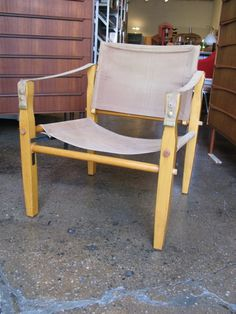 "Rugged folding camp chair has a well-earned vintage patina. Canvas slings, wooden frame. Chair can be disassembled and folded, so it can be carried in a backpack. Made by Gold Medal Folding Furniture Co. of Racine, WI. Dimensions: 24"" wide by 23"" deep by 28"" high."