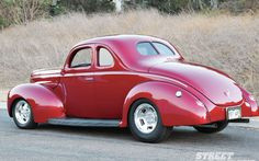 1940 Ford Standard Coupe.  I had one like this in 1973 and drove it from Ft. Lauderdale to Montreal to Vancouver to San Bernadino and back to Florida. The trunk wouldn't lock, so I slept there when it was raining too hard to set up the tent . . .