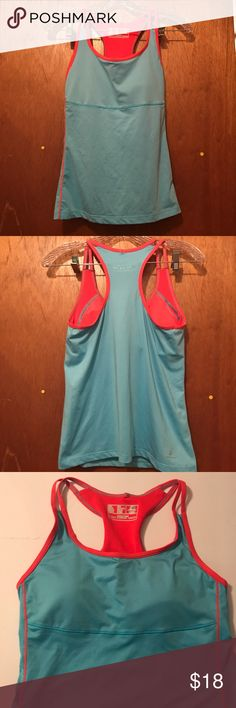 Workout tank top size medium built in bra top New balance workout tank top. Blue with pink straps and built in bra top. Excellent used condition. Size medium New Balance Tops