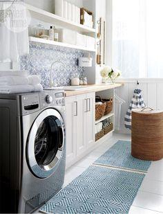 High/low: Beautiful blue laundry room {PHOTO: Michael Nangreaves}