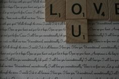 """Love You"" Scrabble Tile Display.  This is super cute, and really sweet with the lyrics of our song on the background."
