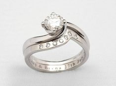 Platinum wedding ring with laser engraving, shaped to fit with engagement ring