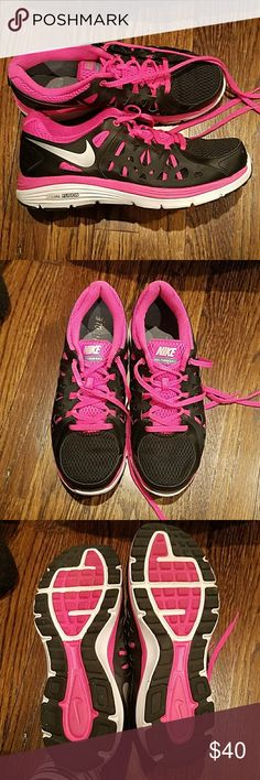 Nike Dual Fusion Size 8.5 Nike Dual Fusion size 8.5 sneakers. Pink and black. Worn a handful of times. Excellent condition. Nike Shoes Sneakers