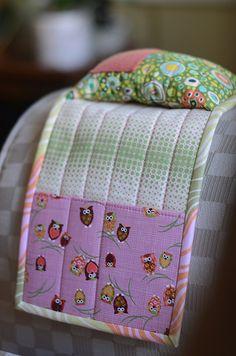Armrest pin cushion