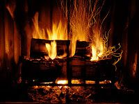 Sitting in front of a roaring fire, cuddled up with my hubby watching a good movie, eating popcorn and drinking cocoa (maybe even with a hint of Kahlua, tee hee)!