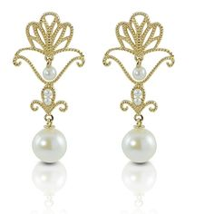 14k yellow gold and feature two 7.58MM freshwater pearls as well as precious seed pearls.