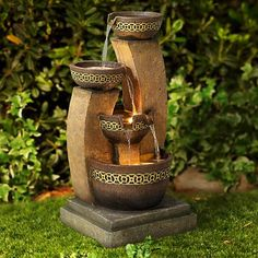 Three decorative bowls empty out into one large pot in this indoor or outdoor fountain.
