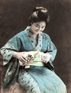 Young woman in country kimono.  Hand-colored photo, 1890's, Japan.  Photographer K. Tamamura.
