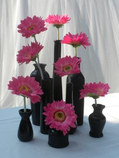 Let your centerpieces play double duty!  Set of 8 Vintage Black Painted Bud Vases for centerpieces and wedding favors by TheWeddingDesignShop, $36.00