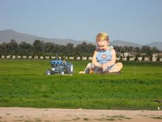 Giant baby and his tractors along I -10 in Goodyear, Arizona (about 20 miles west of Phoenix) - photo by rayman, via Waymarking;  This is made from a photo, blown up and put on boards.  There used to also be a more normal sized man and woman, as well.    ...Apparently it was removed in 2012...