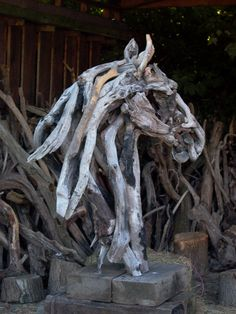 Small original interior driftwood bronze horse sculptures & reliefs. THIS IS SO FREAKING COOL! I want this as a decoration out side my dream stables! :)