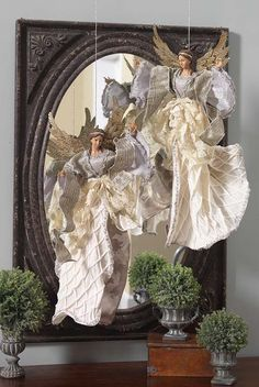 These angels from the Yuletide Chic collection are suspended in front of the mirror for a stunning effect. I would like to use fishing line for an invisible effect. Magical Christmas, Elegant Christmas, Christmas Nativity, Christmas Love, Country Christmas, Christmas Angels, Beautiful Christmas, Vintage Christmas, Christmas Holidays