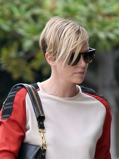 Charlize Theron Photos Photos - Charlize Theron looks fashionable and shows off her cute new hairstyle while taking her faux-hawk-rocking son Jackson out to breakfast in Los Angeles, California on September 20, 2013. - Charlize Theron Spends the Day with Her Son