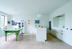 Great kitchen setting. Love the green table.
