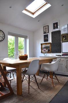 art in kitchen. light. wood. white. black.
