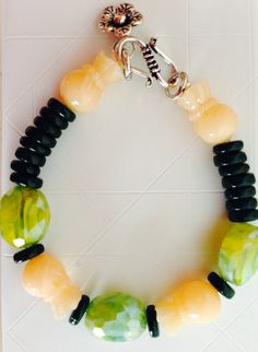 Spring delight :) green and peach beads on wire with a flower charm bracelet !!