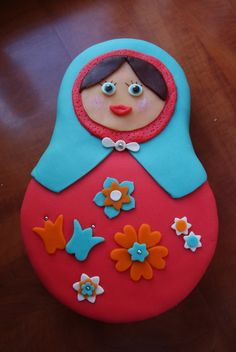 Matryoshka cake! Minus crazy lips and eyes...cupcake tops same design as dress