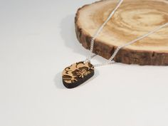 Bamboo and Solid Silver Pebble Shaped Pendant with by BeamDesigns