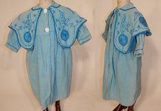 Edwardian Blue Embroidered Soutache Braided Trim Childs Winter Coat This antique Edwardian era blue embroidered soutache braided trim child's winter coat dates from 1910. It is made of a blue soft cotton fabric, with a slightly darker shade of blue silk soutache embroidered braided rope trim along the collar and sleeve cuffs.