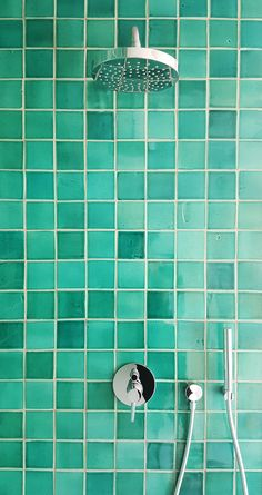 Many shades of turquoise on 10x10cm handmade tiles.