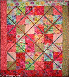 """Diamond Girl"" quilt kit at Snappy Quilts. Kaffe Fassett fabrics. Colorful florals are paired with a few coordinating woven stripes as sashing"