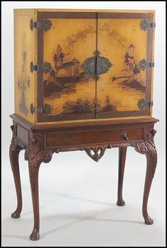 "CHINOISERIE STYLE CABINET. Raised on Chippendale style base 63"" x 39"" x 21"""