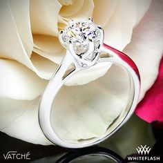 """Superb craftsmanship is on full display with the Vatche """"Swan"""" Solitaire Engagement Ring. This 6 prong beauty incorporates an open cathedral style shank with four surprise diamonds nestled within the gallery of the head for that extra little sparkle."""