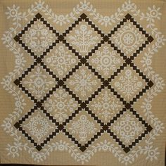 """Whitework Sampler, 79x79"""", by Tommie Crocker.  Hand appliquéd, machine quilted by Cynthia Clark. Design by The Rabbit Factory (Ontario, Canada)"""