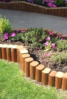 Check out the creative use of landscape timbers as borders. Cut them into sections of varying lengths and sink them into the ground.  Awesome.