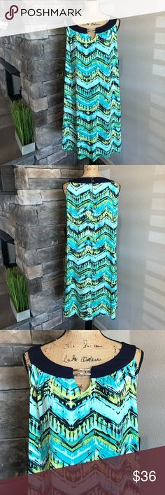 Curvy Blue Splashwave Dress NWT! 💐Great spring & summer dress. Navy blue trim and shades of aqua/green. Keyhole opening with silver hardware in the front. Keyhole opening in the back fastens with 2 silver buttons. New condition! Kim Rogers Dresses Midi