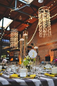Dramatic table florals are emphasized by spot lights Small fixtures