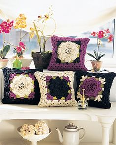 From the description: A delicate thread bedspread from the Fifties gets new life as an unexpected set of chunky, flowery pillows.
