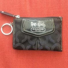 "REDUCEDCoach Madison Op Art Mini Skinny coin purse Authentic. Coach Signature Optic Art Lurex Fabric. Leather Trim. Zip Top Closure with Leather Pull. Front Embossed Coach Horse & Carriage Logo. Exterior Slip Compartments. Interior  Sateen Fabric Lining. Dimensions:     4.5""(L) x 3.25""(H). Excellent Condition Coach Bags Wallets"