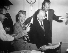 """Notorious prankster Alfred Hitchcock has designs on birthday girl, Doris Day - on the set of """"The Man Who Knew Too Much"""" 1956, and James Stewart watches."""