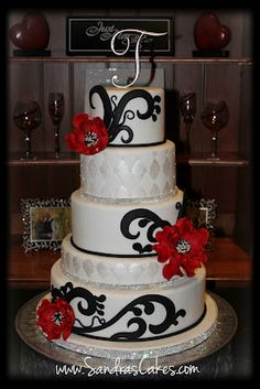 Red white and black from http://sandrascakes.blogspot.co.uk/2012/09/red-black-and-white-wedding-cake.html