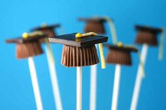 Mini Reeses, chocolate squares, and sour belts make perfect bite sized mortarboards.