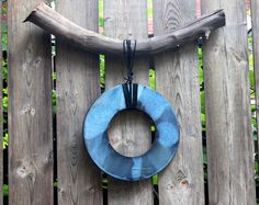 Outdoor Ceramic wall art dream catcher with driftwood handmade by ZibuDesigns in North America. ZibuDesigns - culturally Inspired Objects of exceptional Design. #ZibuDesigns, #FunctionalArt, #ArtForSale, #Driftwood, #Handmade, #WallArtDecor, #Art, #WallArt, #Ceramics, #CeramicArt, #CeramicWallArt, #Artwork, #UniqueArtwork, #UniqueArt, #CulturalInspiration, #Oneofakind, #LifeStyle, #ContemporaryArt, #Design